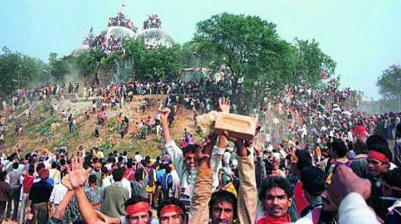 In this file photo, kar sevaks celebrate after demolishing the Babri Masjid in Ayodhya on December 6, 1992. (Photo: File)