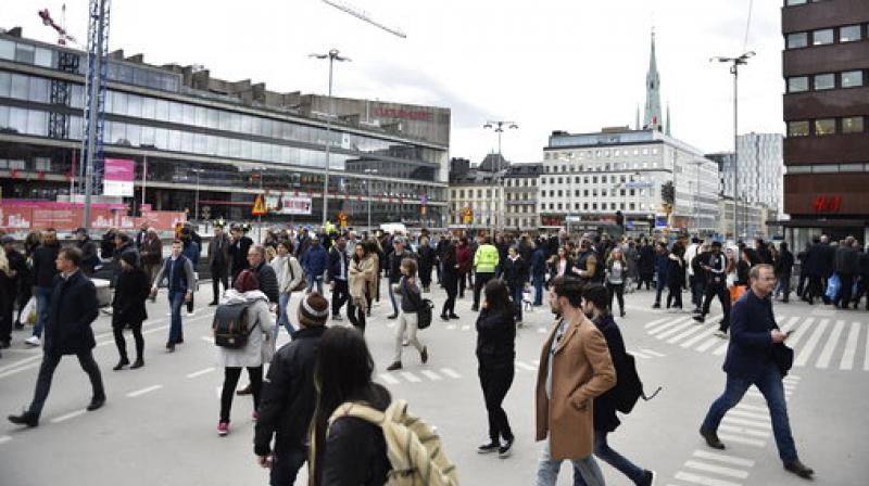 People walk away fro the scene after a truck crashed into a department store injuring several people in central Stockholm, Sweden, Friday April 7, 2017. (Photo: AP)