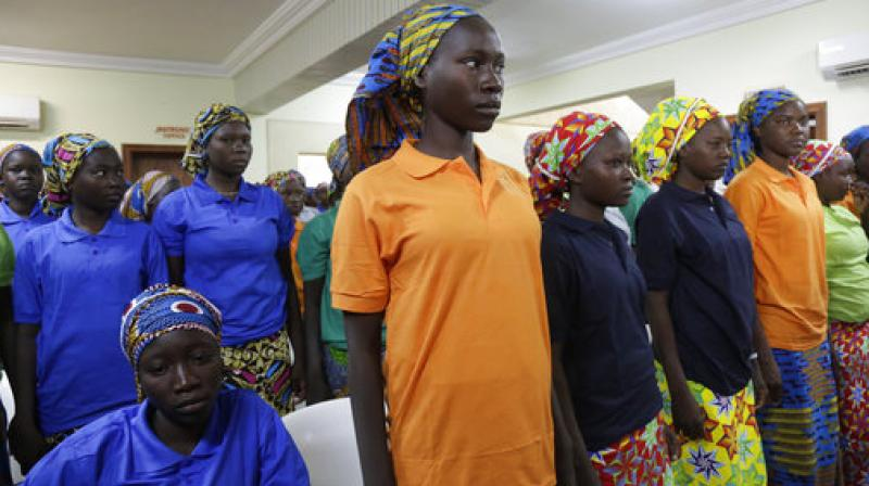 Chibok schoolgirls, recently freed from Nigeria extremist captivity, are photographed in Abuja, Nigeria. (Photo: AP)