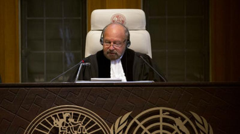 Presiding judge Ronny Abraham of France, centre, reads the World Court's verdict in the case brought by India against Pakistan in The Hague, Netherlands, Thursday, May 18, 2017. (Photo: AP)