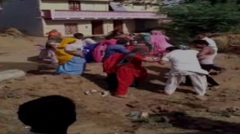 After the video went viral, the police have now registered a case against the sarpanch's family including four other people. (Photo: ANI Twitter)