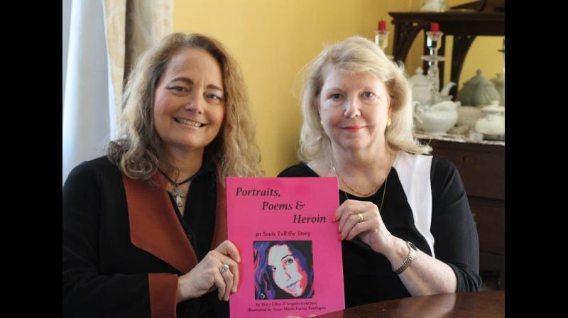 Poet Mary Ellen D'Angelo-Lombardi (left) and artist Anne Marie Zanfagna display their book on Monday, May 7, 2018 in Plaistow, N.H. The book, called