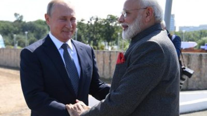 File image of PM Prime Minister Narendra Modi and Russian PM Putin. (ANI)