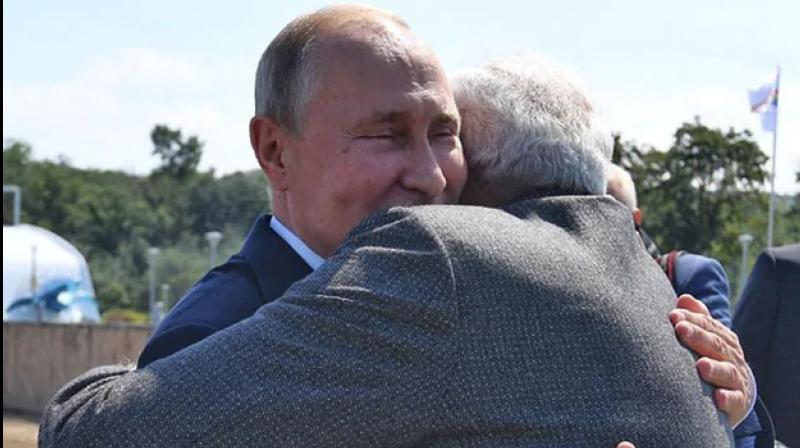 PM Prime Minister Narendra Modi and Russian PM Putin also hugged and shook hands before their departure for Zvezda ship-building complex. (Photo: ANI)