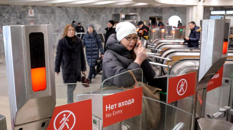 In this representative image, commuters walk through ticket gates equipped with facial recognition systems at a metro station in Moscow on January 27, 2020. (Photo | AFP)