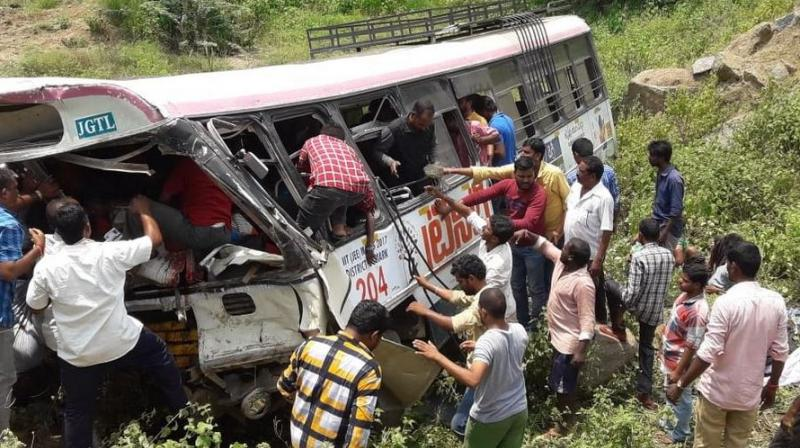 The bus belonging to Jagtial depot had 60 passengers and was proceeding from Shanivarapet village to Jagtial via Kondagattu ghat road and Muthyampet villages when it fell into valley. (Photo: Twitter | ANI)