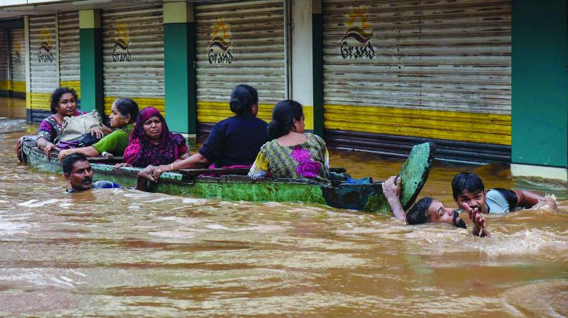 People being rescued from a flood-affected region following heavy monsoon rainfall in Kochi. (Photo: PTI)