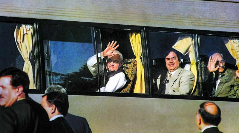 Former PM Atal Behari Vajpayee waves from the maiden Delhi-Lahore bus service on his arrival at Lahore. (Photo: PTI)