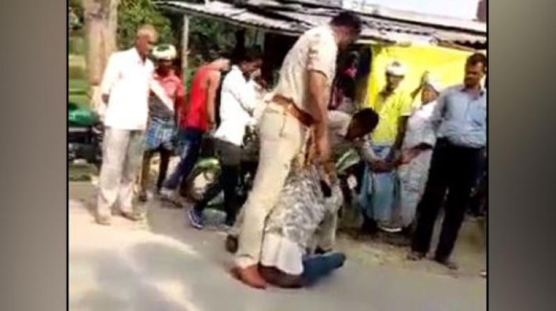 The video which was recorded by a bystander shows sub inspector Virendra Mishra and head constable Mahendra Prasad beating him up and verbally abusing him. (Photo: ANI)