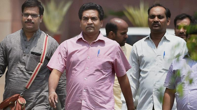 AAP MLA Kapil Mishra comes out after submitting a report against Delhi CM Kejriwal and Health Minister Satyender Jain to ACB, in New Delhi. (Photo: PTI)