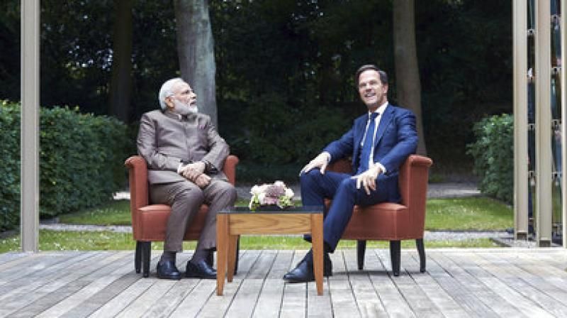 Indian Prime Minister Narendra Modi, left, and Dutch Prime Minister Mark Rutte during a meeting in the garden of the Catshuis residence in The Hague, Netherlands, Tuesday, June 27, 2017. Modi has met his Dutch counterpart during a brief stop in the Netherlands on his way home from meeting President Donald Trump in Washington, D.C. (AP Photo/Phil Nijhuis)