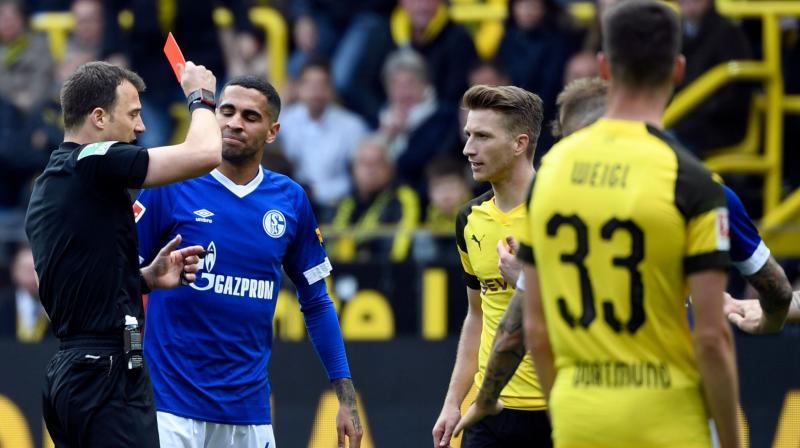 Wolf's ban means his season is over as Dortmund have three matches to play while Reus will only be available for their final match at Borussia Moenchengladbach. (Photo: AP)