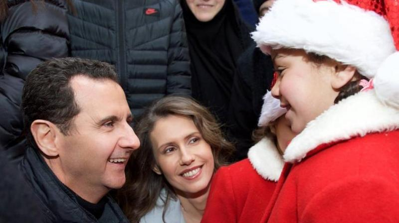 The Syrian President, along with his wife, an orphanage in Abbey on Sunday. (Photo: Facebook)