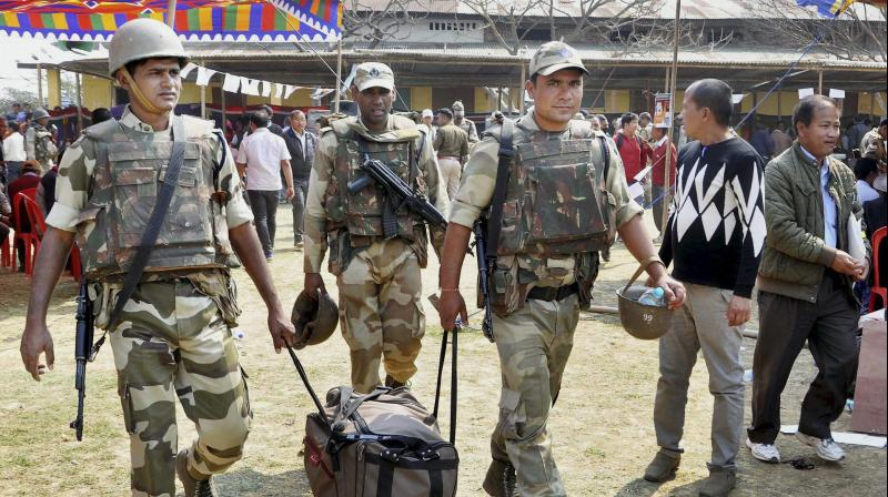 Security personnel leave for election duty on the eve of voting for the Assembly polls at Porompat, Imphal East. (Photo: PTI)