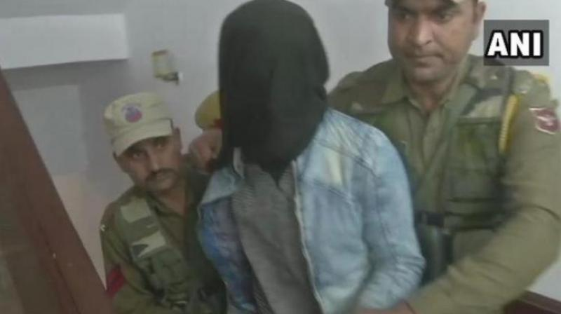 The 'juvenile' was nabbed immediately after he allegedly threw the grenade at the Jammu bus stand that left two people dead and 29 injured on March 7. (Image: ANI)