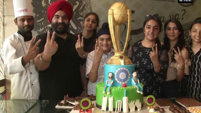 The World Cup-shaped cake also has a Board of Control for Cricket in India (BCCI) logo on it. (Photo: ANI)