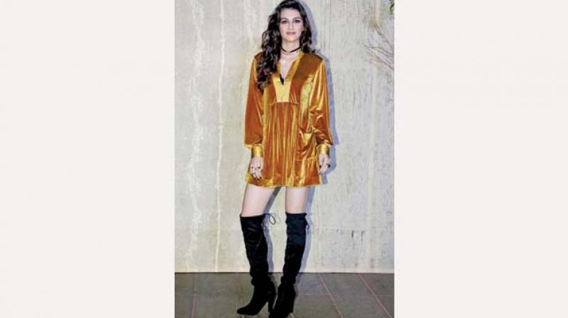 Kriti Sanon looks serene in this gold number paired with knee high boots