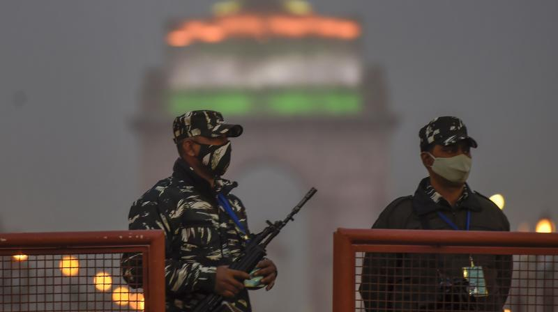 Security personnel keep vigil at Rajpath on the eve of 72nd Republic Day, in New Delhi, Monday, Jan. 25, 2021. (PTI /Kamal Singh)