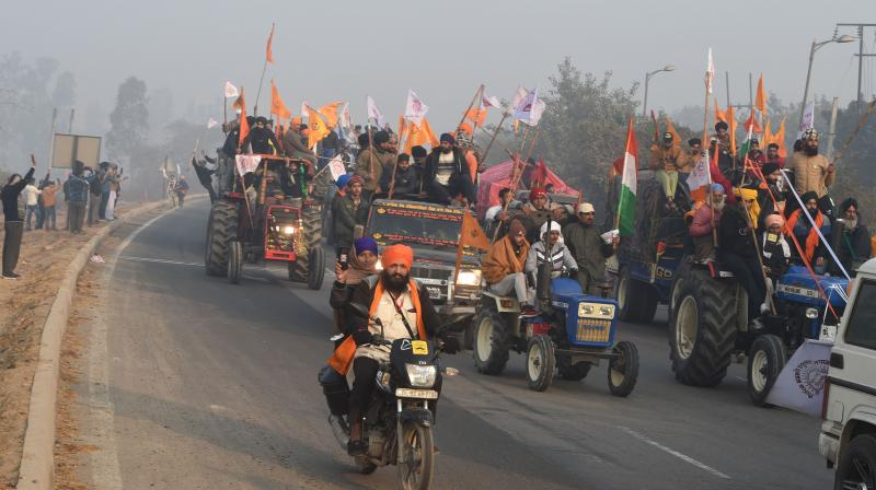 Farmers on their tractors move towards Delhi during their rally on Republic Day, at Singhu border in New Delhi, Tuesday, January 26, 2021. (PTI/Shahbaz Khan)