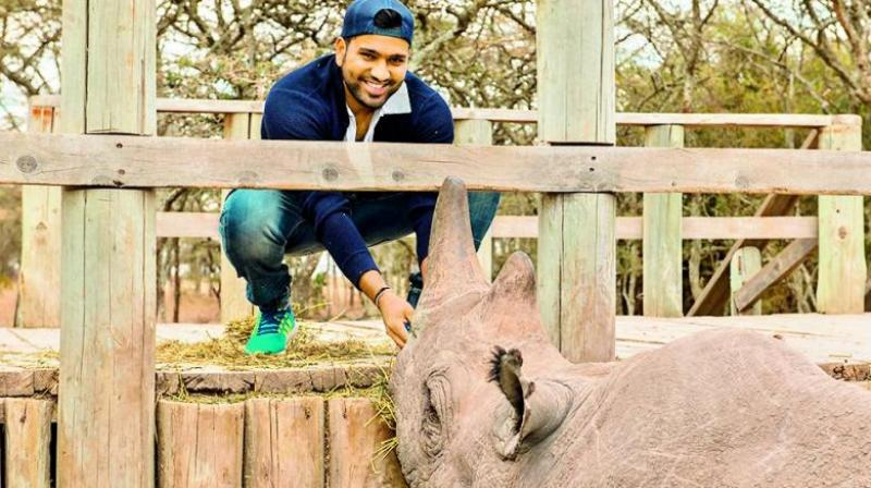 Rohit Sharma with the black rhino,