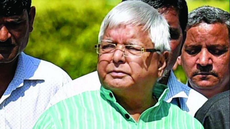 Court summoned RJD chief Lalu Prasad Yadav, his wife Rabri Devi and son Tejaswi Yadav and others as accused in the Indian Railway Catering and Tourism Corporation (IRCTC) scam. (Photo: File)