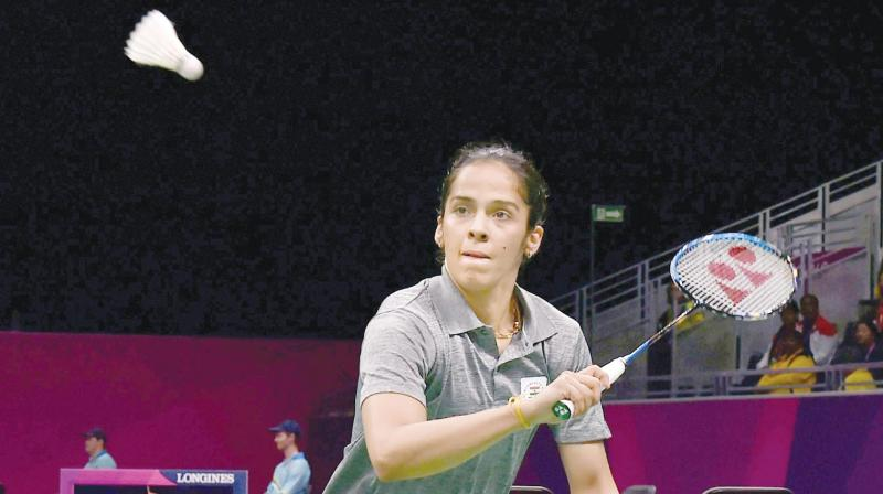 Saina Nehwal in action against Pakistan's Mahoor Shahzad in their women's singles match of the team event in Gold Coast. (Photo: PTI )