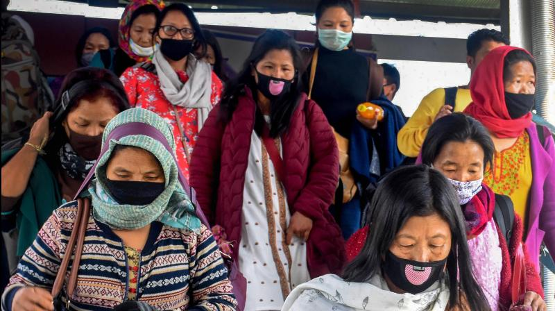 Passengers wear protective masks in the wake of novel coronavirus scare at Guwahati Railway Station in Guwahati. (PTI)