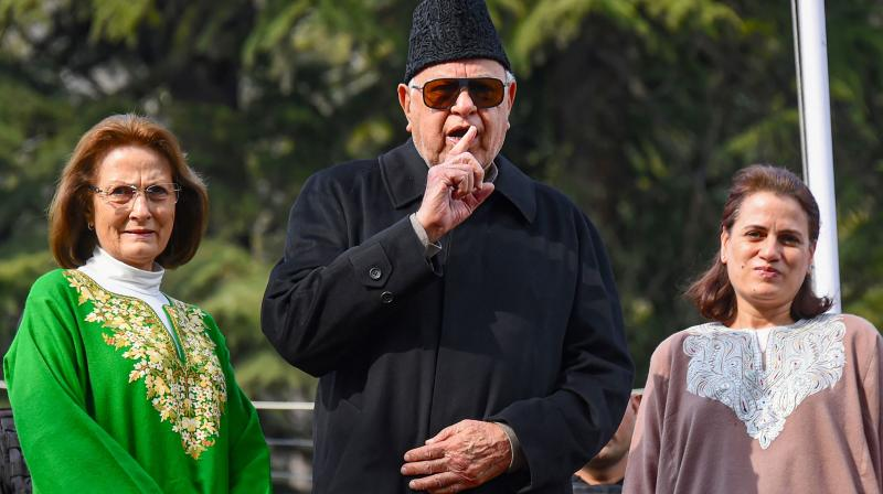 National Conference patron Farooq Abdullah with his wife Mollie Abdullah (left) and daughter Safiya Abdullah (right) speaks to the media after his detention under the Public Safety Act (PSA) was revoked by the Jammu & Kashmir administration on March 13, 2020. (PTI)