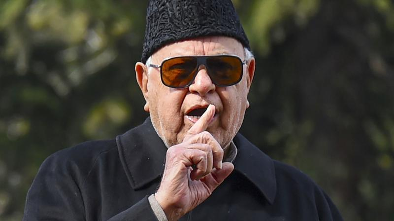 National Conference patron Farooq Abdullah with his wife Mollie Abdullah (left) and daughter Safiya Abdullah (right) speaks to the media after his release from detention on March 13, 2020. (PTI)