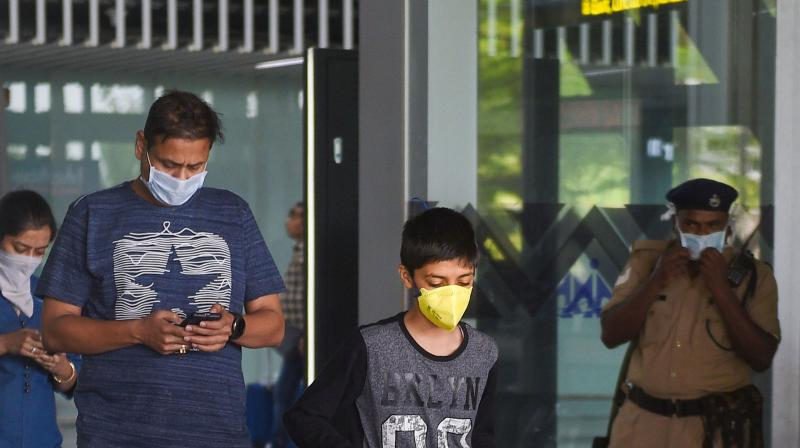 Passengers landing at the Kolkata airport wear masks in the wake of the coronavirus scare. (PTI)
