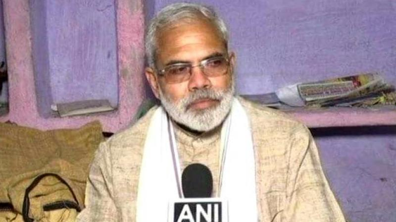 'I am taken aback by seeing how the BJP is working in contrast to what PM Modi actually thinks and says. People have been asking me 'Acche din kab ayenge' (when will good days come)?' PM Modi's lookalike Abhinandan Pathak said. (Photo: ANI)