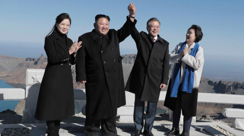 North Korean leader Kim and his wife Ri Sol Ju stand with South Korean President Moon and his wife Kim Jung-sook on top of Mount Paektu. (Photo: AFP)