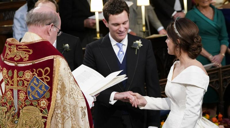 The nuptials have drawn most senior members of the royal family, including Eugenie's grandmother, Queen Elizabeth II, who will host a champagne luncheon for the newlyweds shortly after the ceremony.(Photo: AP)