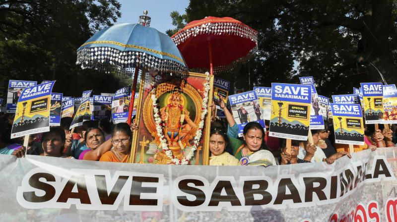 Devotees raised slogans and held pictures of Lord Ayyappa, placards as a part of their 'Save Sabarimala' campaign steered by the state unit of BJP-led NDA. (Photo: PTI)