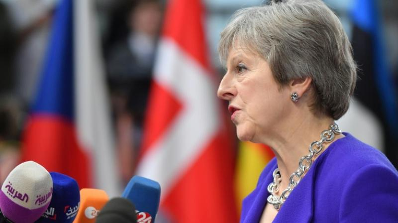 Prime Minister Theresa May says she Britain will consider extending the transition period after Brexit for a few months. (Photo: AFP)