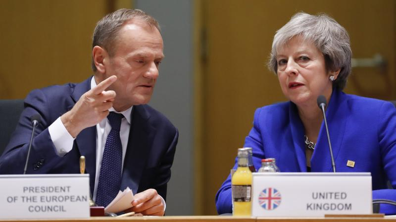 British Prime Minister Theresa May, right, and European Council President Donald Tusk attend a round table meeting at an EU summit in Brussels, Sunday, Nov. 25, 2018. (Photo: AP)