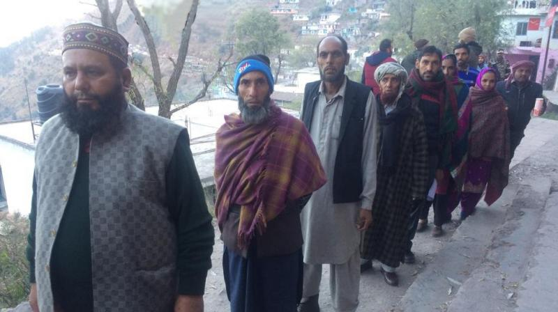 People queue up to vote in Reasi's Chassana area in the seventh phase of polling. (Photo: Twitter | ANI)