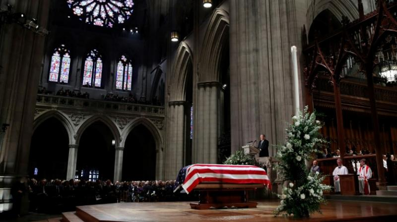 George W Bush delivers a eulogy beside the flag-draped casket of his father George HW Bush, during his state funeral at Washington National Cathedral. (Photo: AFP)