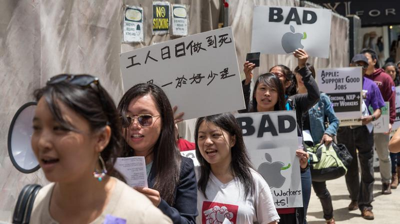 A representative image of a protest over allegations that Apple supply chains used sweat shop labour to make their products (Photo | Flickr - Annette Bernhardt)