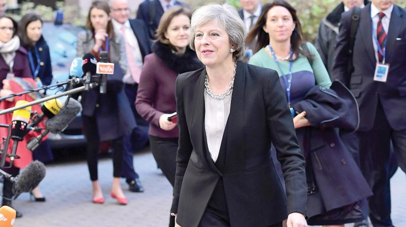 British Prime Minister Theresa May arrives for the European Union leaders' summit at the European Council in Brussels. (Photo: AFP)