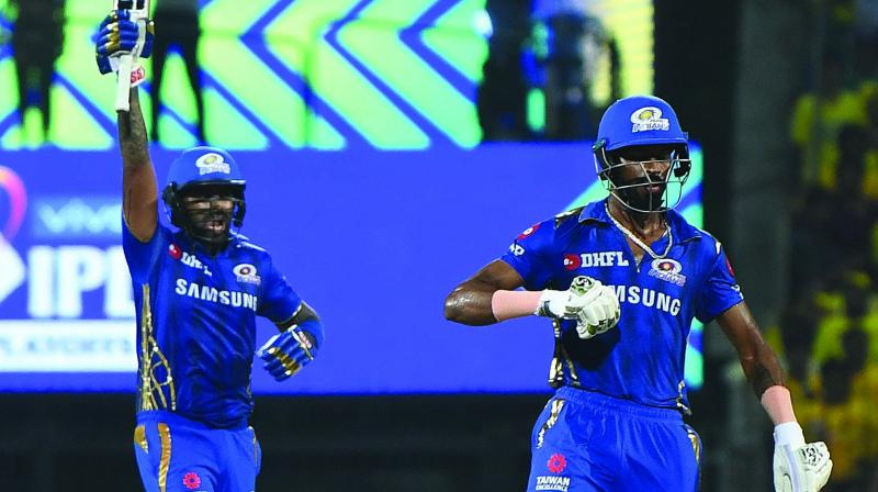 Suryakumar Yadav (left) and Hardik Pandya celebrate Mumbai Indians' victory over Chennai Super Kings in Qualifier-1 on Tuesday. (Photo: EK Sanjay)