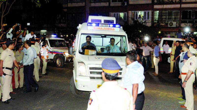 The ambulance brings Sridevi's body to her Green Acres  residence in Lokhandwala, Andheri on Tuesday night. (Photo: PTI)