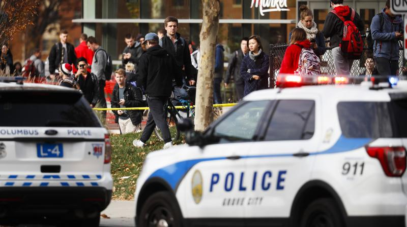 Students leave buildings surrounding Watts Hall as police respond to reports of a shooting on campus at Ohio State University. (Photo: AP)
