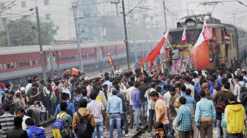 All India Students Federation and Chhtrara Janadhikar Party activists stop a train during the Bharat Bandh called by Left parties in Patna. (Photo: File | PTI)