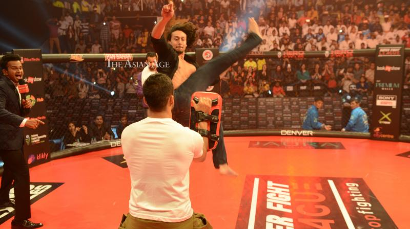 Tiger Shroff was snapped at the Super Fight League competition in Mumbai on Friday where his mother Ayesha and sister Krishna were also spotted along with him. (Photo: Viral Bhayani)