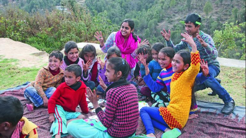 Vidyun Goel with children in a village in Uttarakhand.