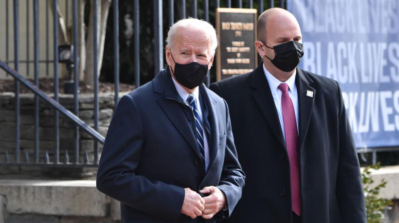 US President Joe Biden(C) leaves Holy Trinity Catholic Church in the Georgetown neighborhood of Washington,DC on January 24, 2021. (Nicholas Kamm / AFP)