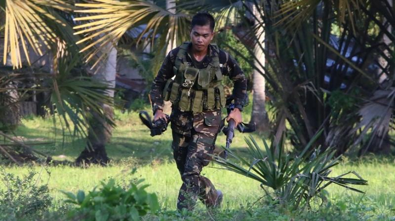 Military chief Ano said troops took the picture of Askali after his death and that captured Abu Sayyaf militants identified the young militant leader.
