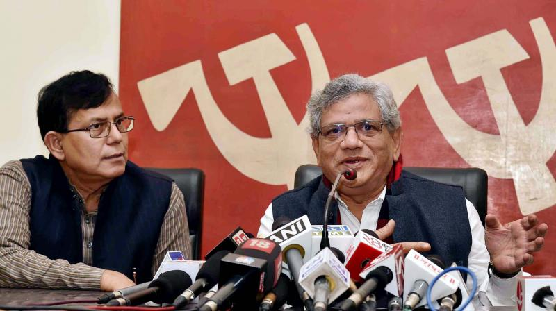 CPI(M) General Secretary Sitaram Yechury interact with media as the party leader Mohammed Salim(L) looks on, at party headquarters at Alimuddin street in Kolkata. (Photo: PTI)