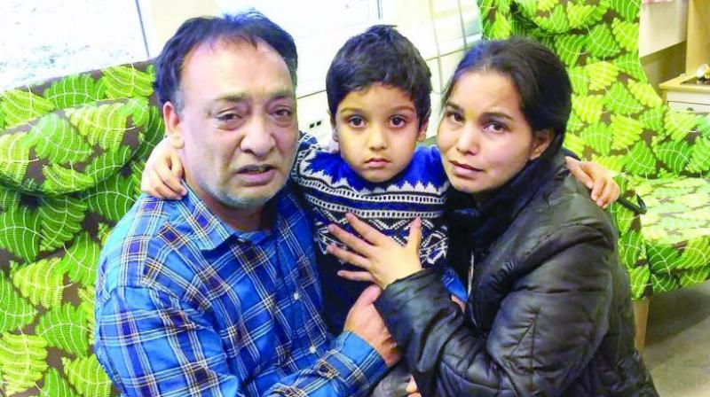 Five-year-old Aryan with his parents in Oslo. The boy was taken away from his parents by Norwegian authorities on a complaint of abuse. (Photo: PTI)